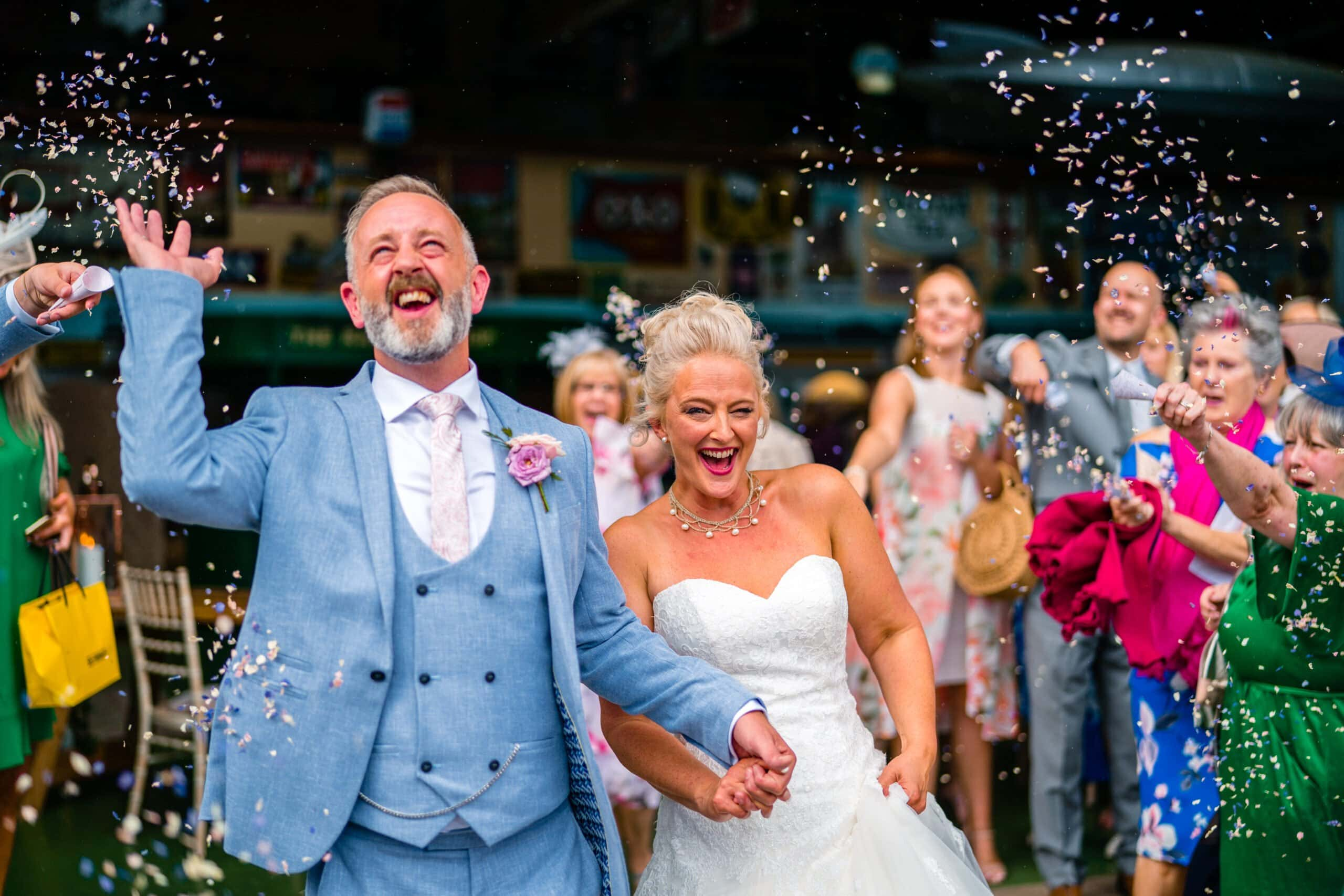 Bride and groom having confetti shot at Fawley Hill wedding venue