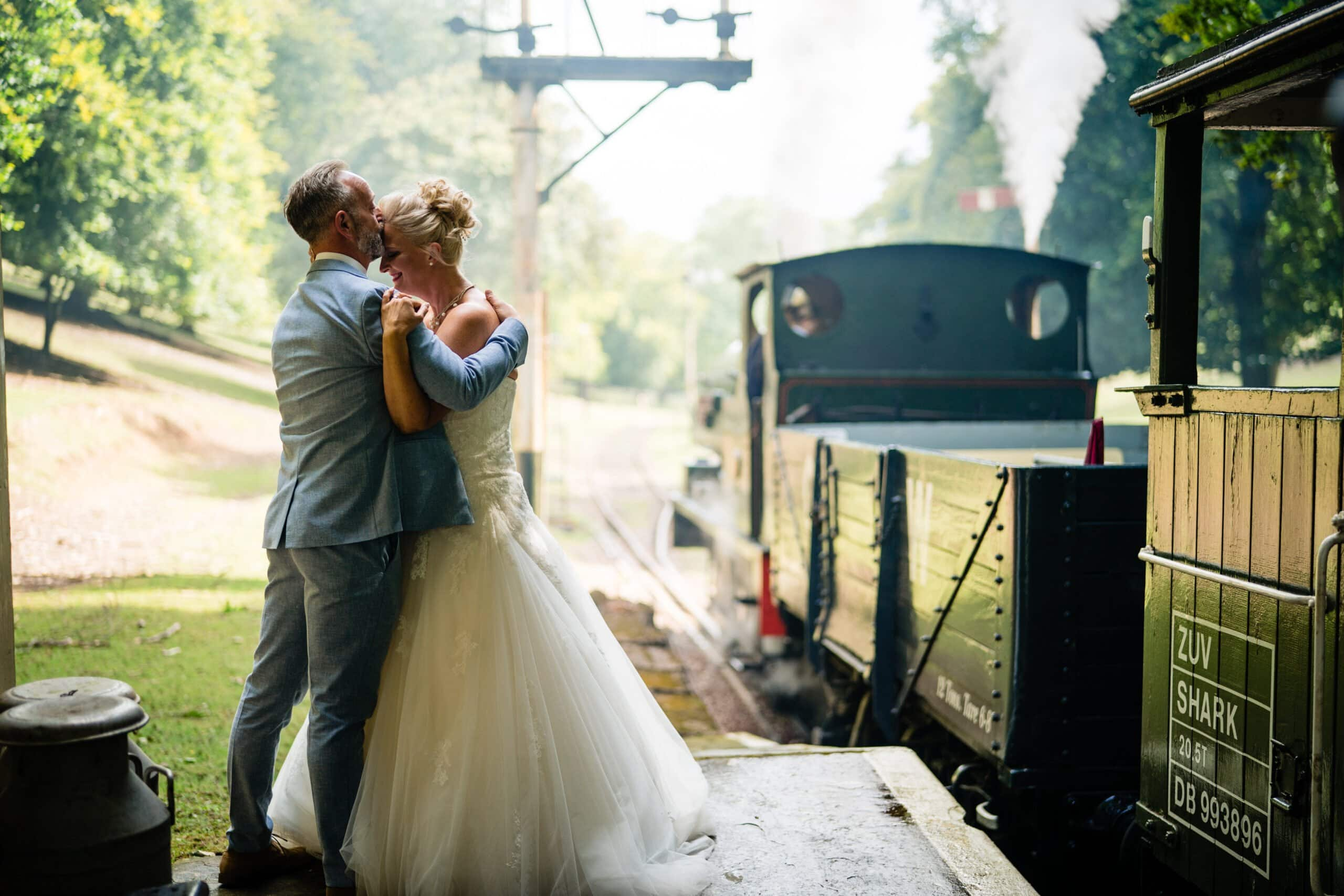 bride and groom with vintage steam train