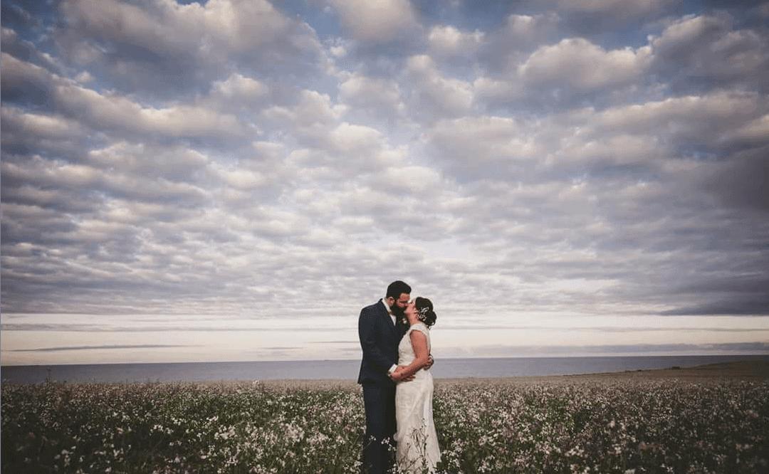 Couple under blue skies at Waxham Great Barn wedding