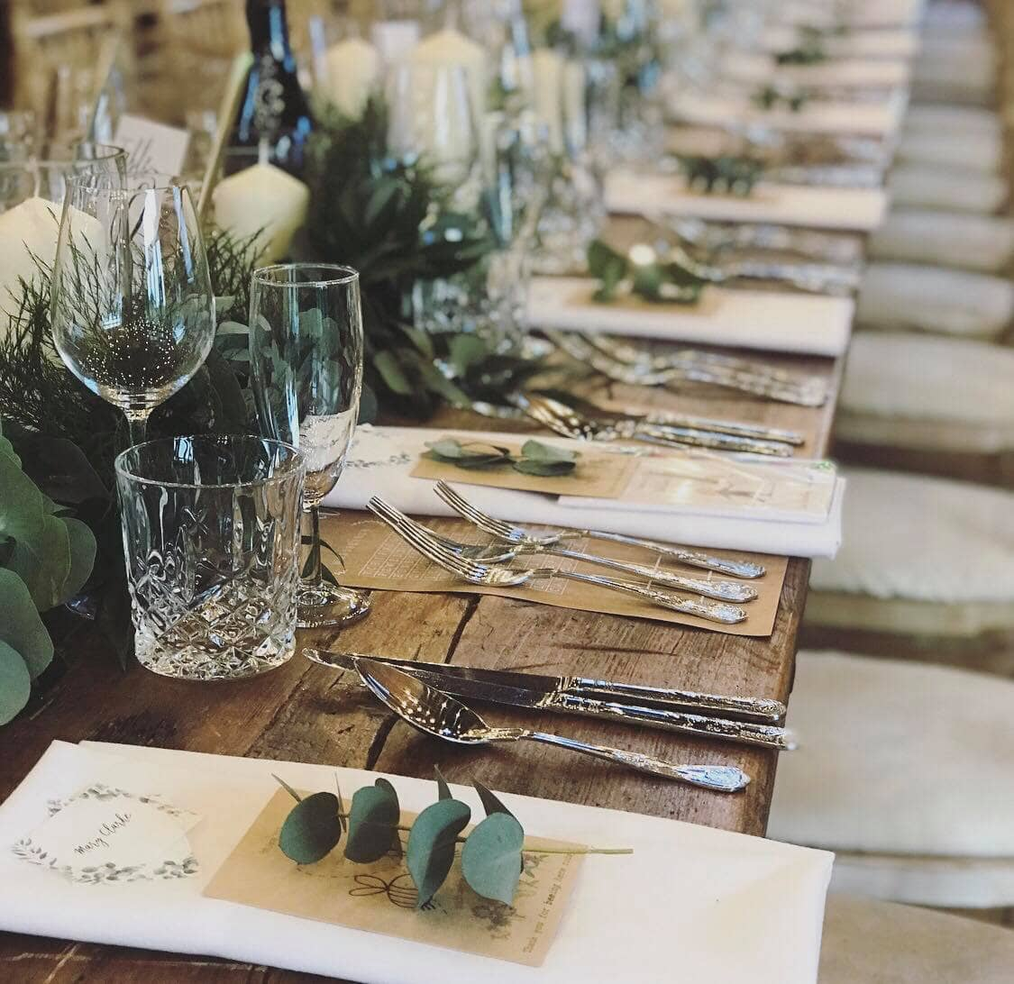 Eucalyptus and crystal glassware at Godwick Hall wedding in Norfolk