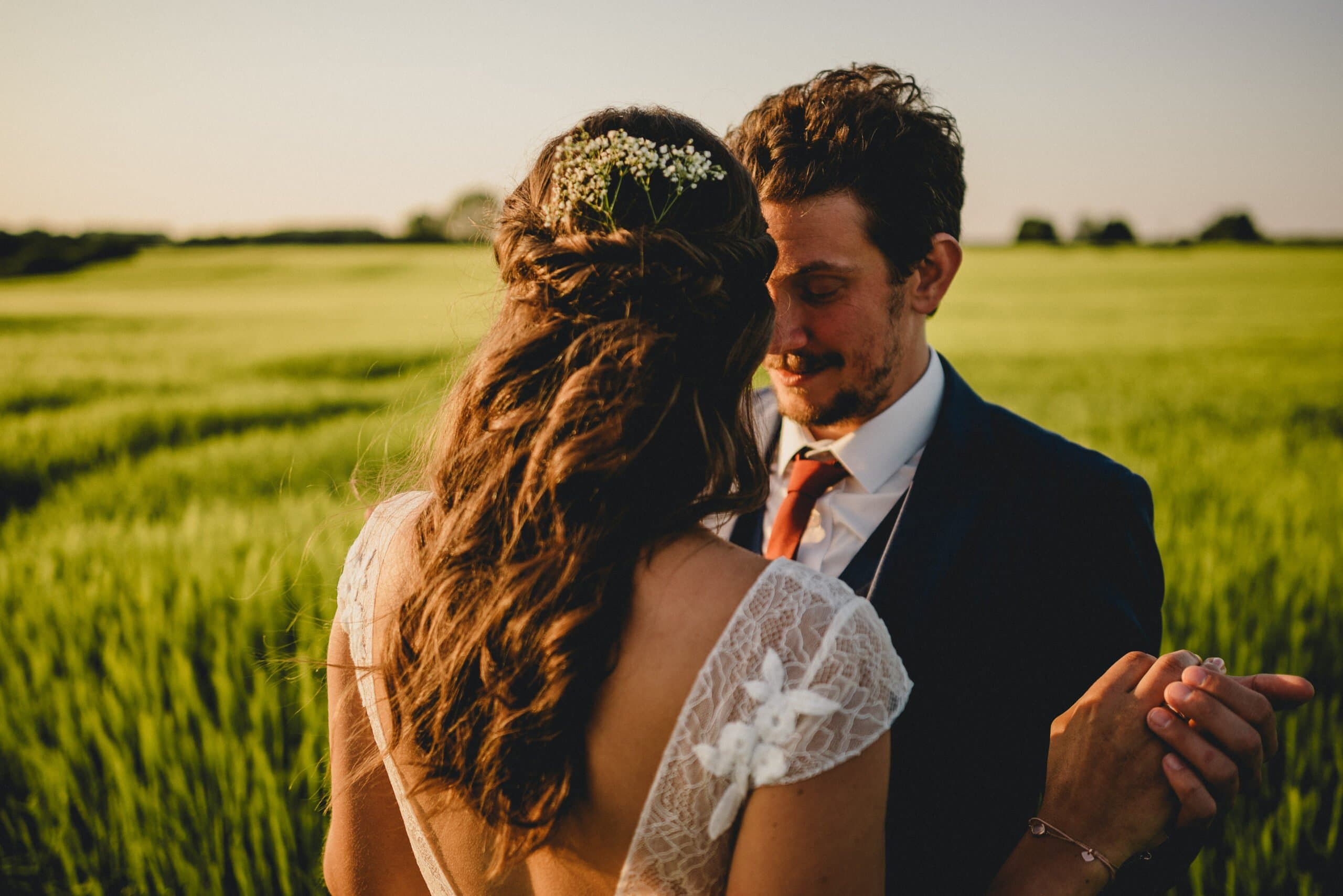 Bride and groom in field at Manor Mews wedding in Norfolk