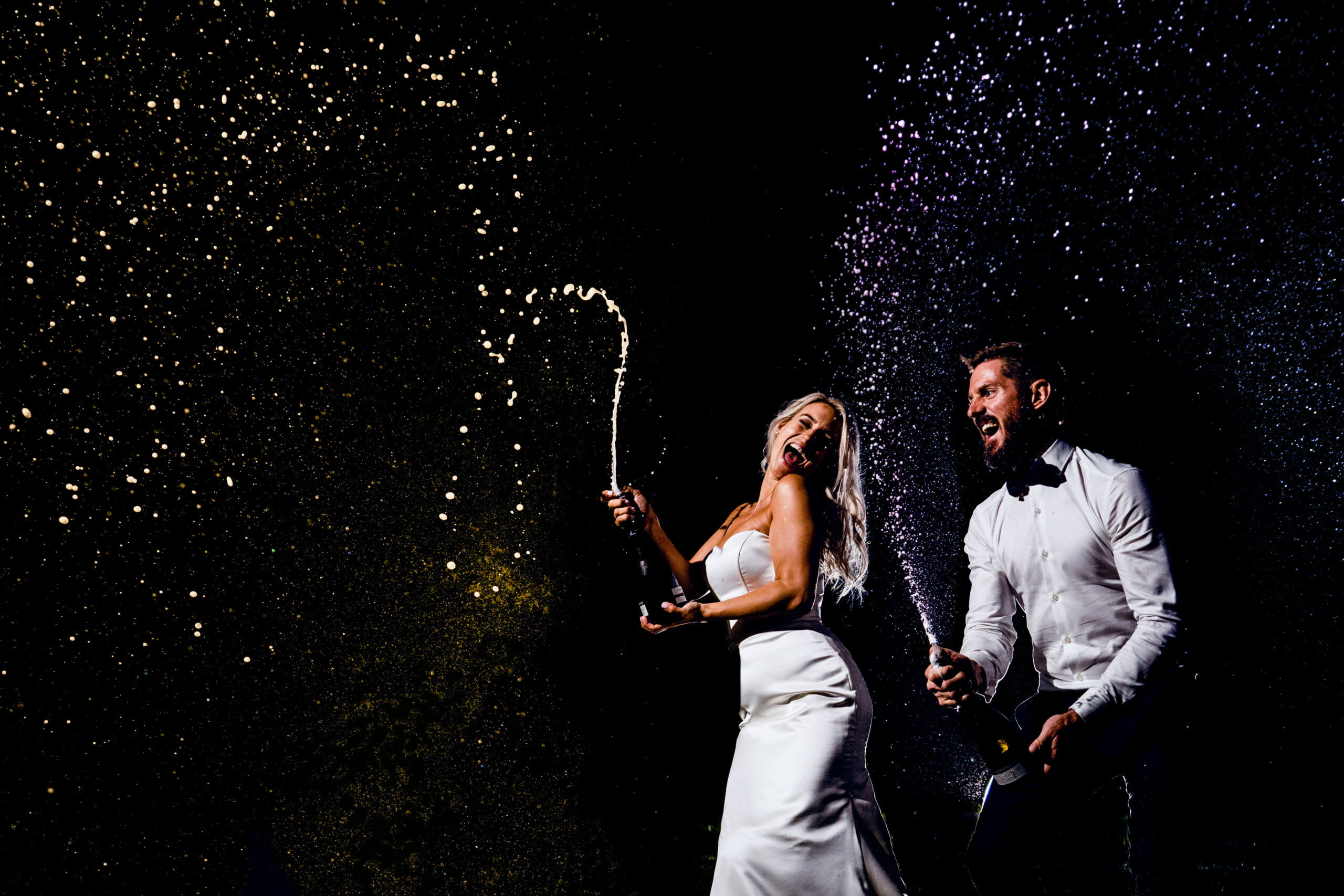 Bride and Groom with champagne at Chaucer Barn Wedding Norfolk