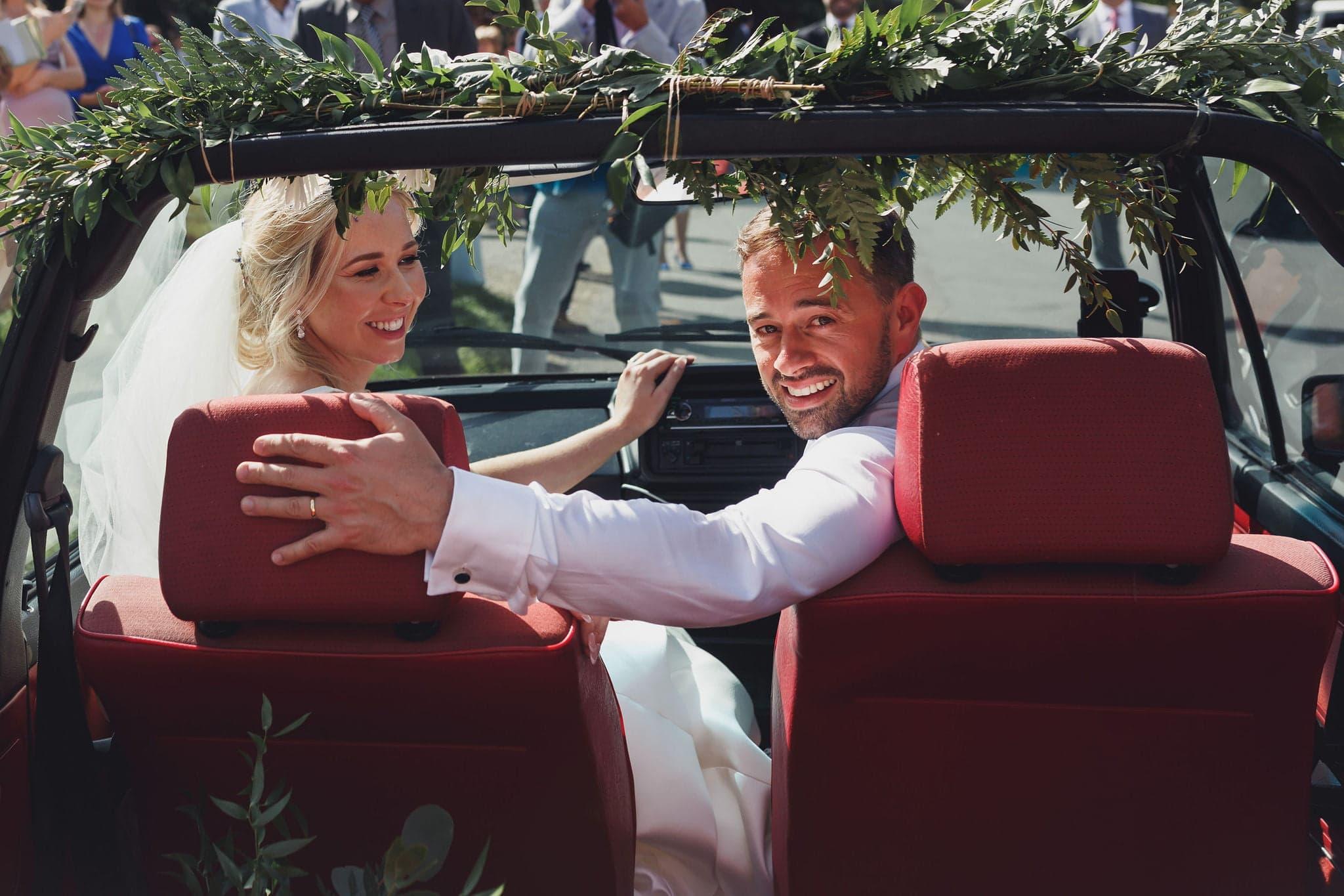 Bride & groom in car at Suffolk tipi wedding