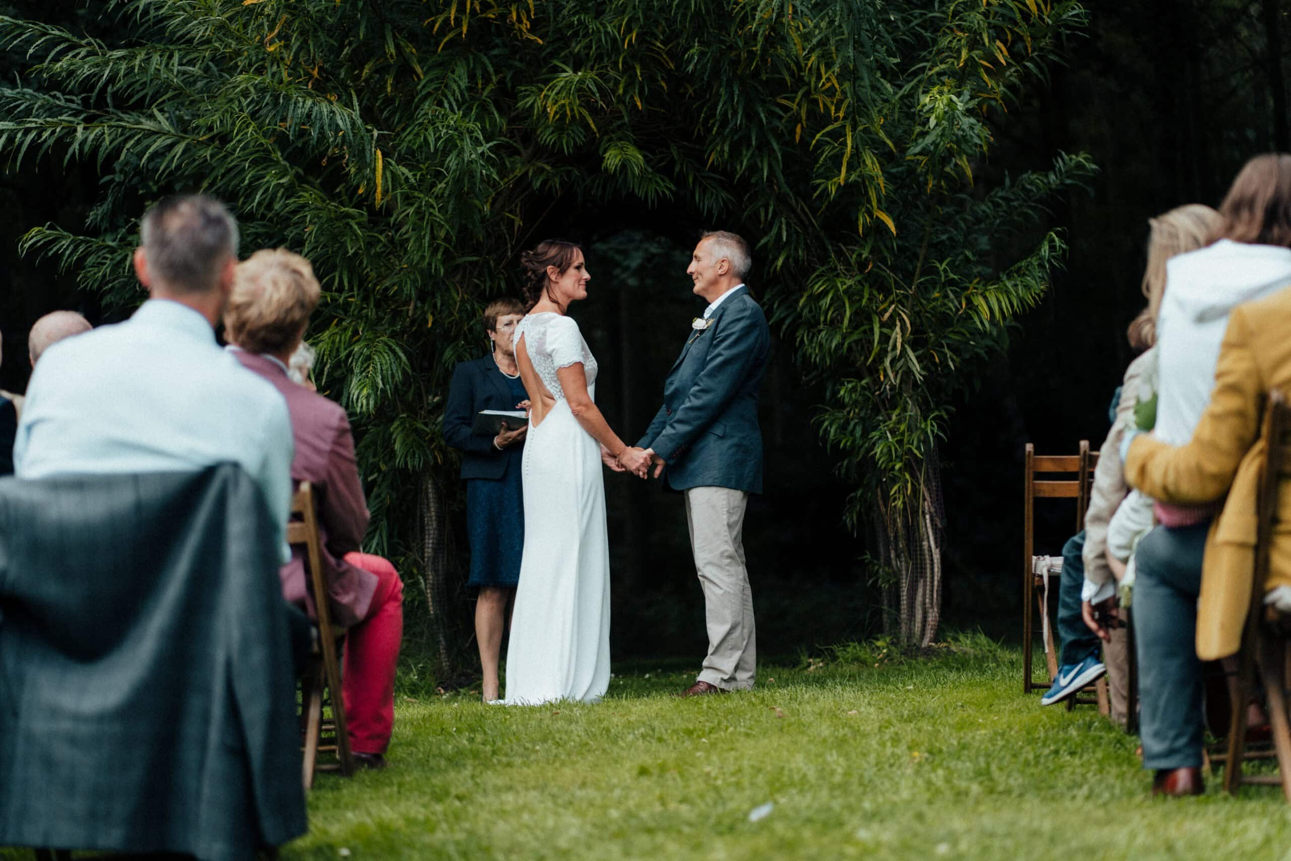 Wedding ceremony in woodland at Chaucer Barn