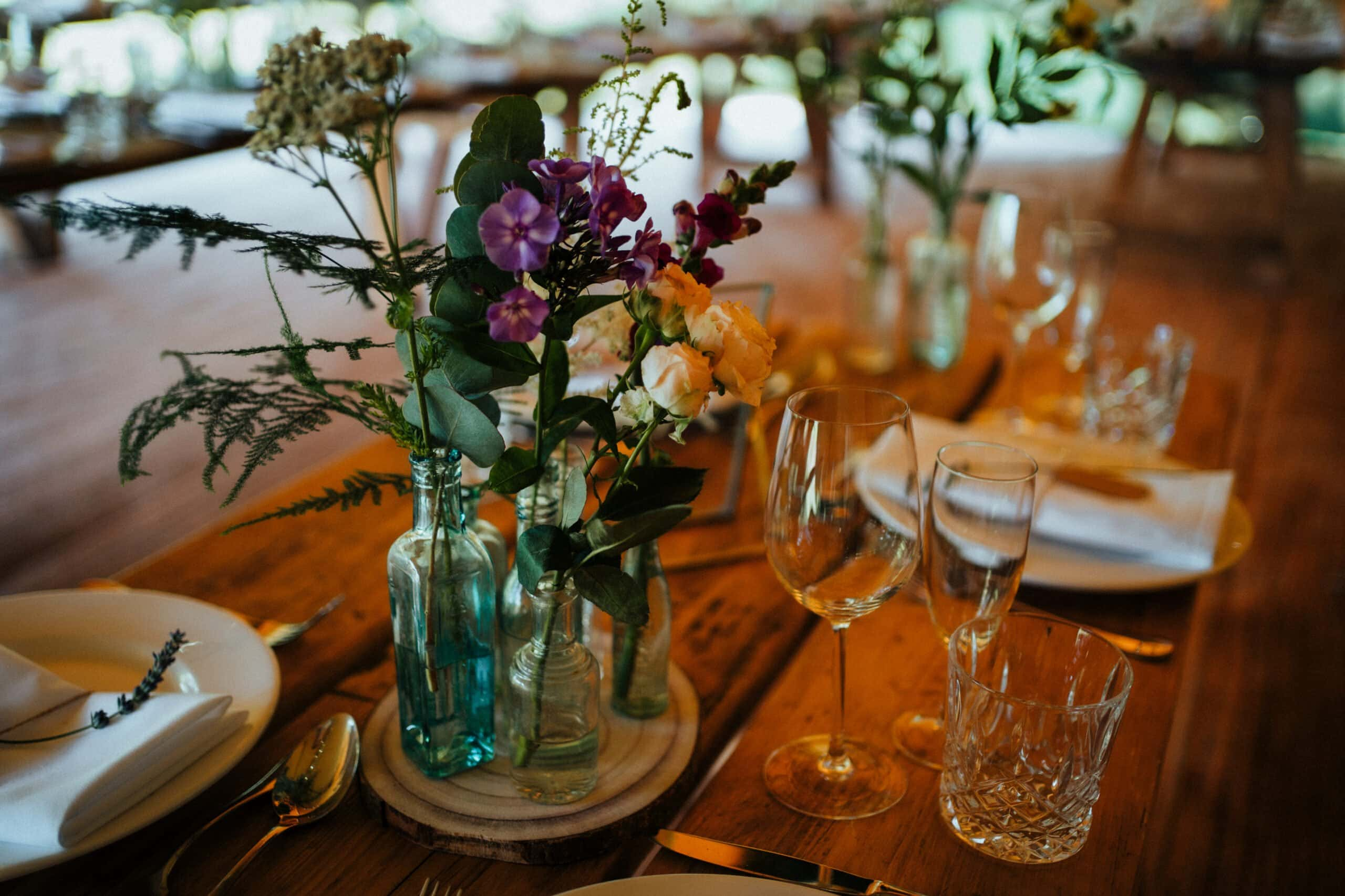 vintage wildflower centrepieces in bottles