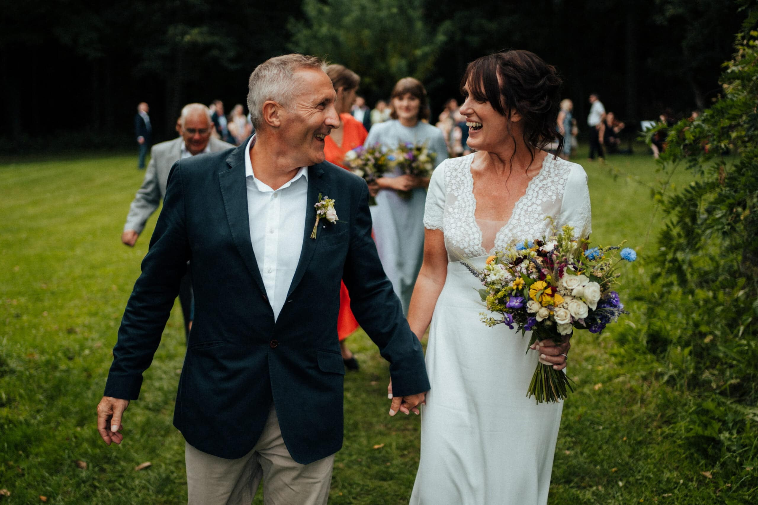Bride and groom with wildflower bouquet at Chaucer Barn wedding ceremony