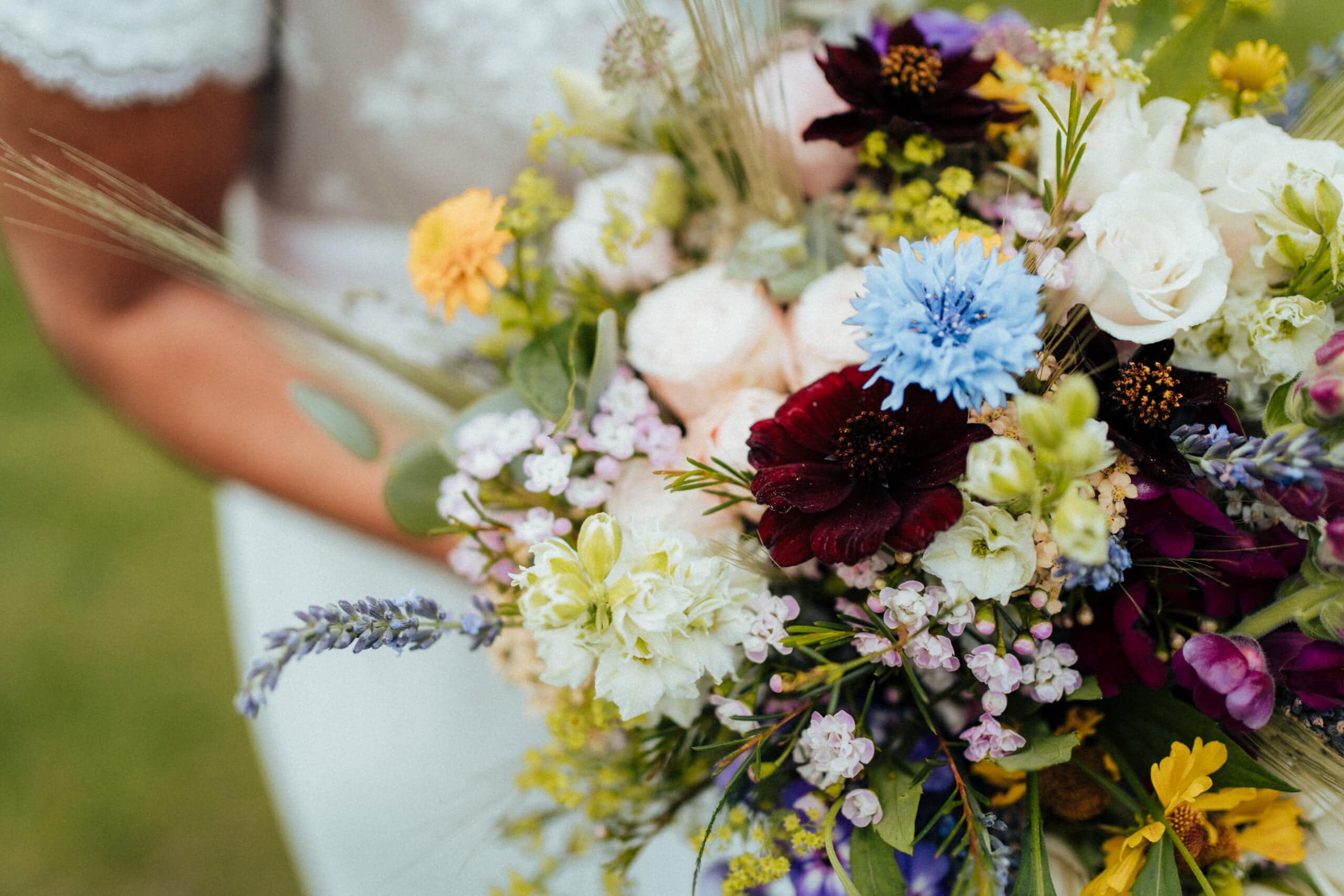 Wilddlower bouquet with bright colours at Chaucer Barn Wedding Venue in Norfolk