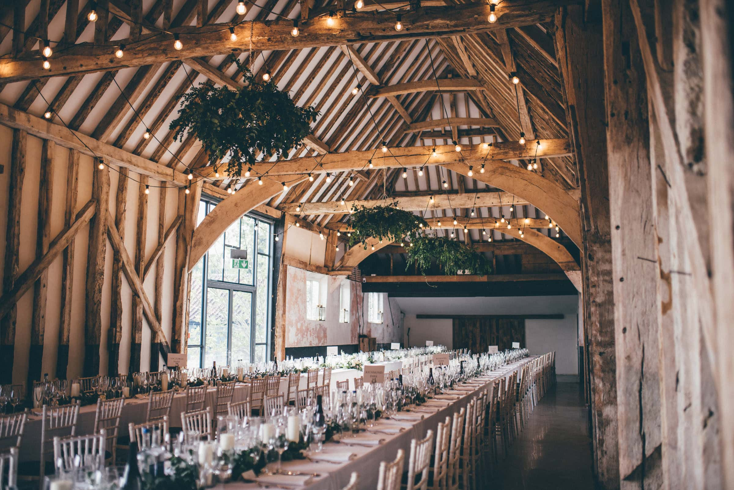 Henham Barns wedding with foliage chandeliers and eucalyptus
