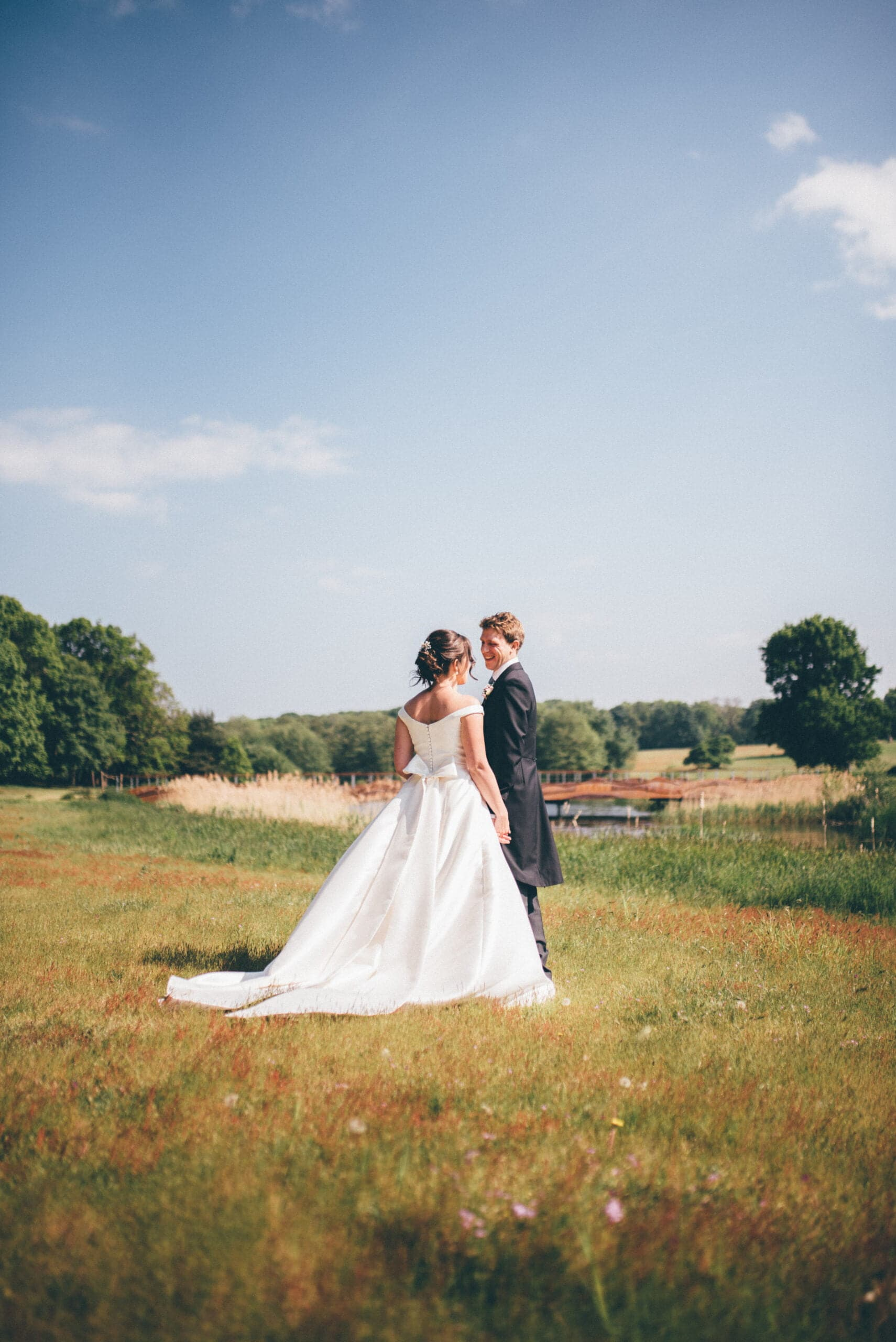 Bride in white dress with groom at henham Barns in Suffolk