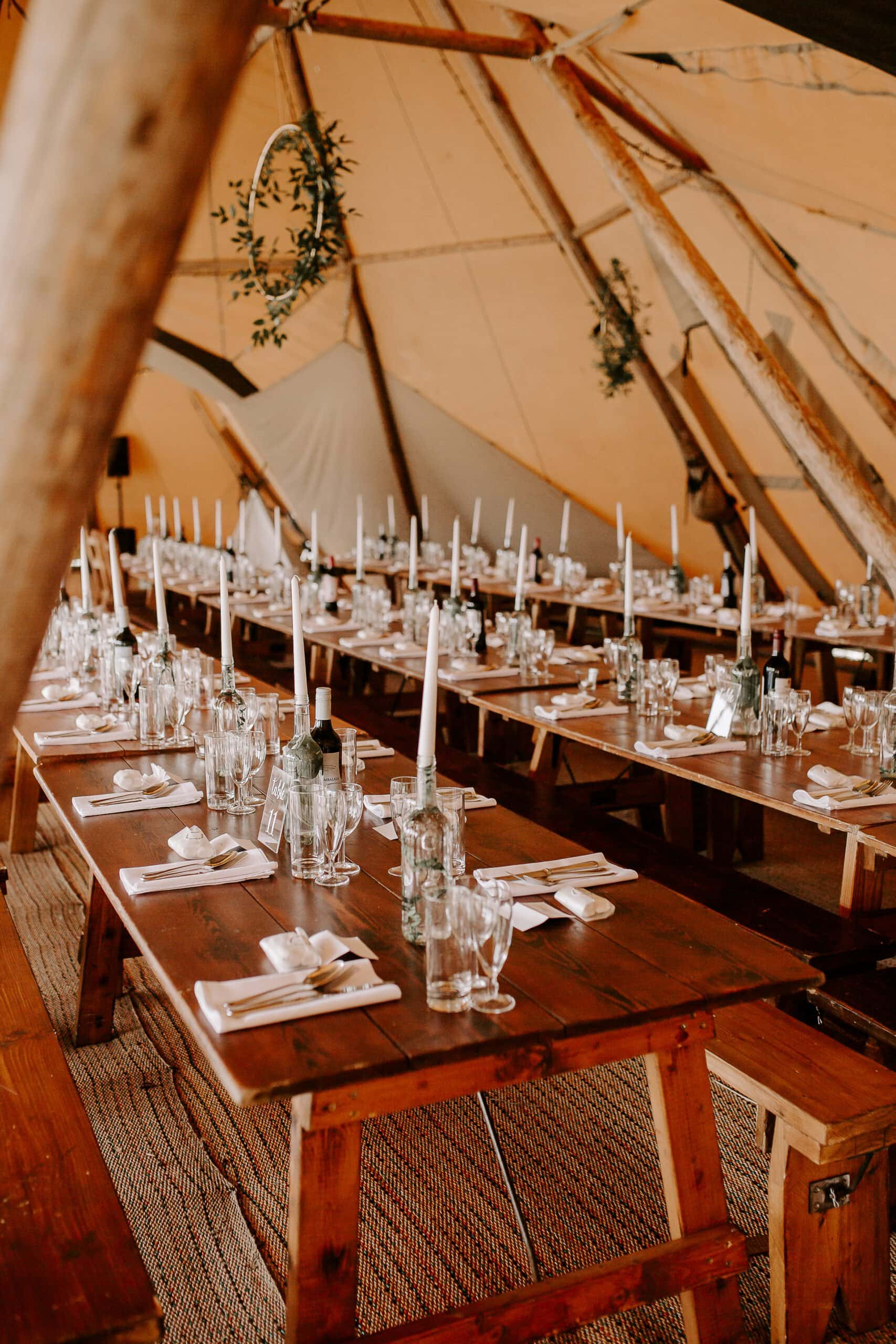 rustic wooden tables at suffolk tipi wedding