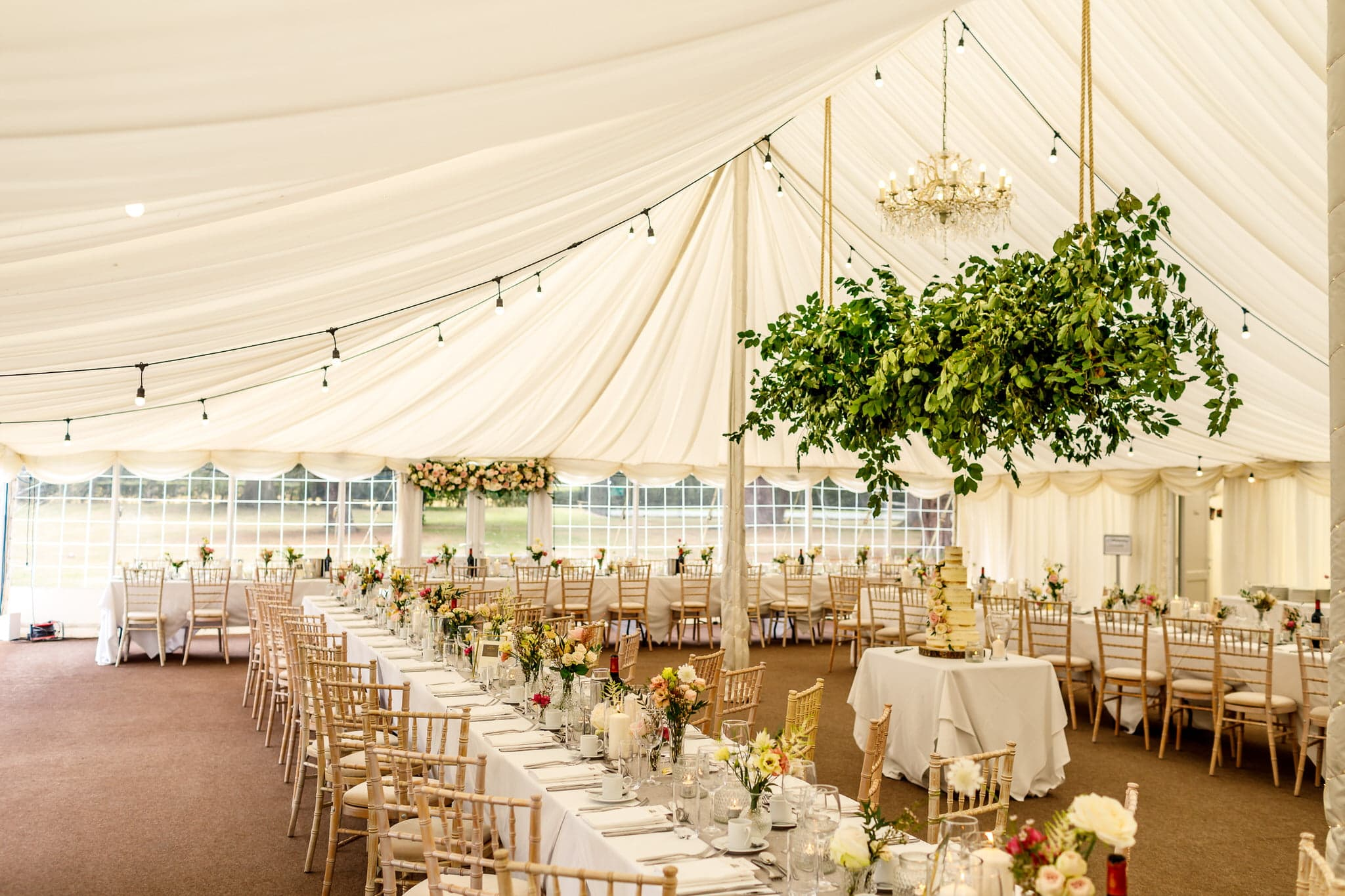 elegant marquee wedding decoration with foliage
