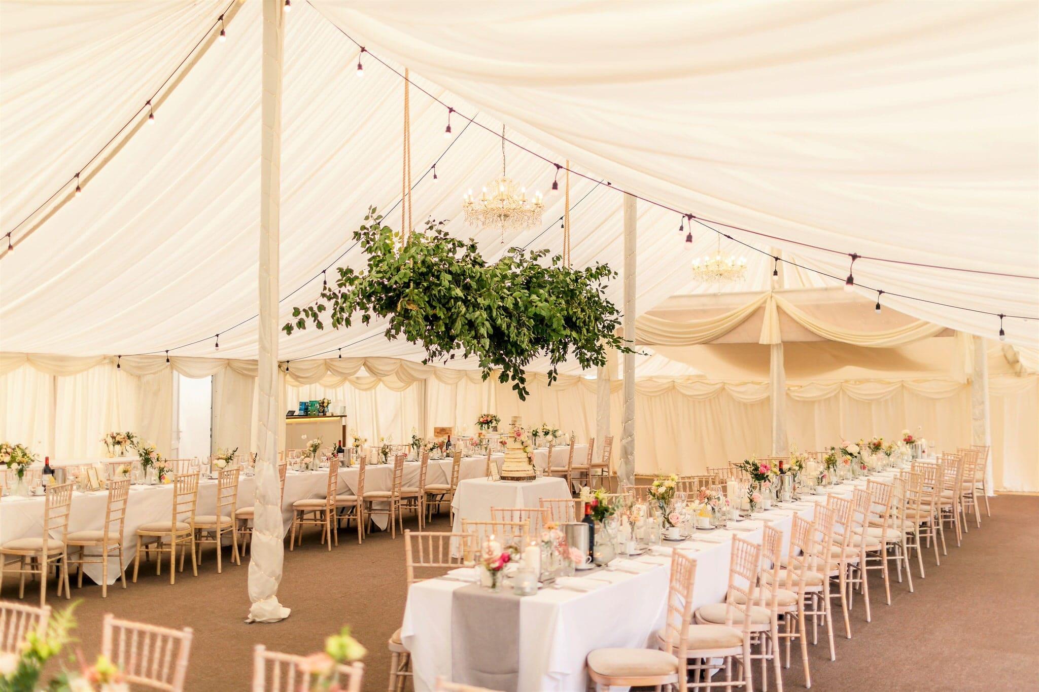 marquee wedding decoration with pink colour scheme
