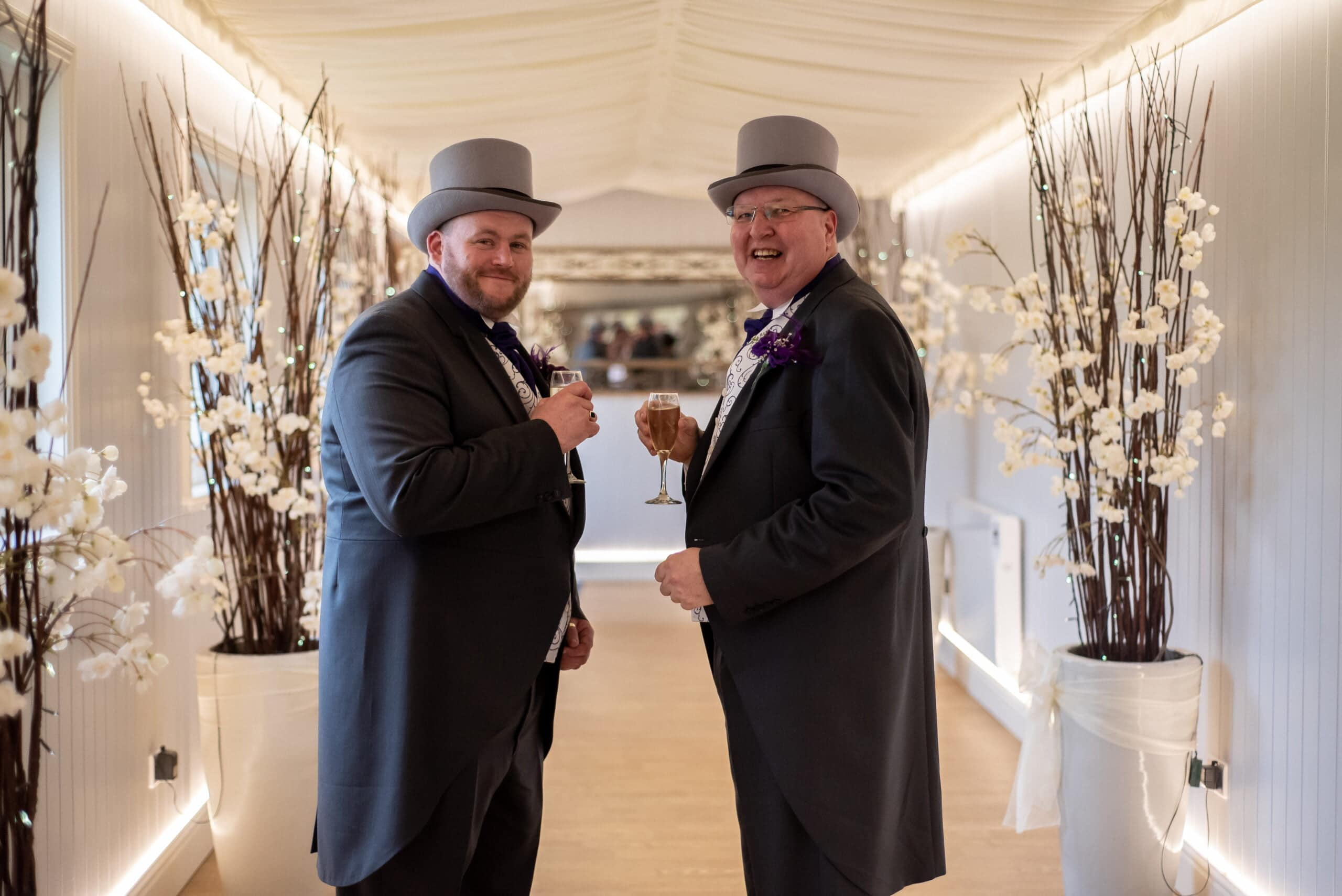 Groom and groom at fennes wedding reception in essex