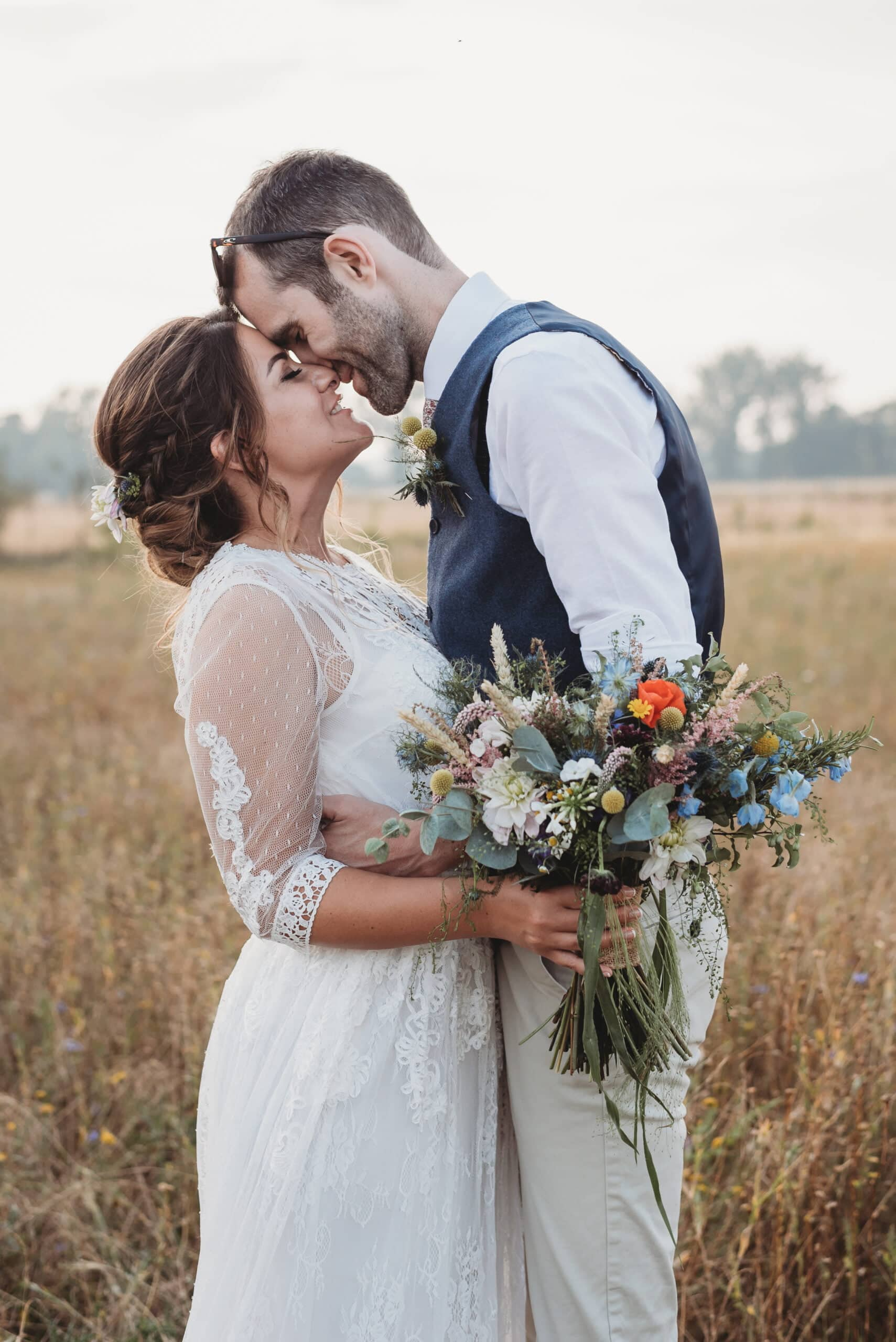 Bride with wildflower bouquet with eucalyptus and groom at Hush Venues Wedding