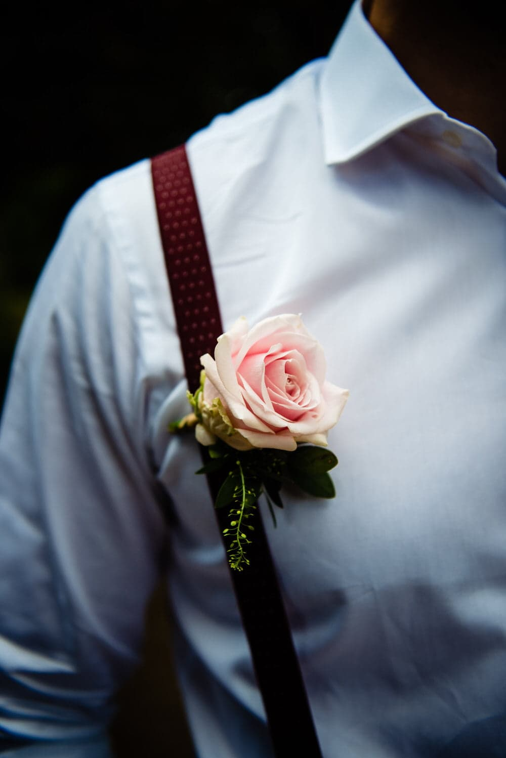 grooms buttonhole by rambling rose florist